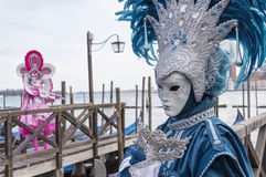 Venice Carnival Masks. Traditional venetian masks posing near Canal Grande in Venice, Italy royalty free stock photos