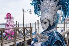 Venice Carnival Masks. Traditional venetian masks posing near Canal Grande in Venice, Italy Royalty Free Stock Photos
