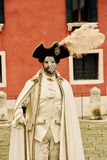 Venice Carnival Participant. A venice Carnival participant masquerading at this historically famous world wide annual event which starts before Easter lent Royalty Free Stock Photography