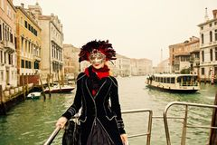 Venice Carnival Participant Landscape shot. A venice Carnival participant posing for a picture and participating at this historically famous world wide annual Royalty Free Stock Photo