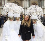 Venice Carnival Participant. S posing for a picture with a member of the general public and participating at this historically famous world wide annual event Stock Image