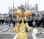 Venice Carnival Participant. S posing for a picture amongst members of the general public and participating at this historically famous world wide annual event Stock Photography
