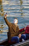 Venice Carnival Reveller Taking Selfie. Venice Carnival reveller selfie posing for a picture amongst members of the general public and participating at this Royalty Free Stock Images