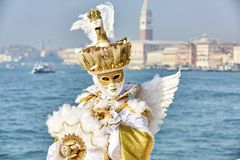 Venice carnival 2017. Venetian Carnival Costume. Venetian Carnival Mask. Venice, Italy. Venetian gold carnival costume. Royalty Free Stock Photography