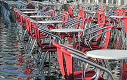 Venice, chairs  with water at high tide Stock Photo