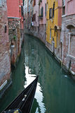 Venice channel with a gondola. Venice channel with part of a gondola royalty free stock photo