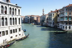Venice channels in the morning. View of the channels of Venice in the morning. Gondola are starting their day royalty free stock image