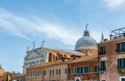Venice Church Beyond Old Brick Buildings royalty free stock photos