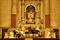 Venice church. Preparation before performance. Preparation at night before wider performance. Commitment to art and purity of music Royalty Free Stock Photos