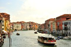 Venice city with boats and taxi , Italy. Venice cityscape with boats and old buildings, Italy. venetian traffic in the water royalty free stock photography