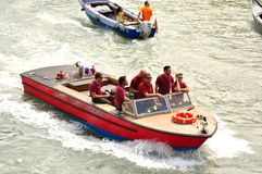 Venice city with firemen in a boat , Italy Stock Image