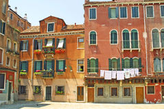 Venice city, Italy. Small plaza with colourful buildings in Venice, Italy royalty free stock photos