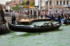 Venice city with old buildings and gondola , Italy. Venice cityscape with gondola boats and old luxury hotels , Italy. venetian traffic in the water .danieli stock images