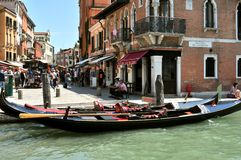 Venice city with old buildings and gondola , Italy. Venice cityscape with gondola boats and old luxury hotels , Italy. venetian traffic in the water .danieli royalty free stock image