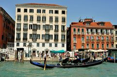 Venice city with old buildings and gondola , Italy. Venice cityscape with gondola boats and old luxury hotels , Italy. venetian traffic in the water .danieli royalty free stock images