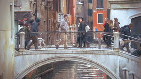 Venice city scene with bridge and walking people stock video footage