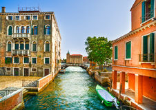 Venice cityscape, boats, water canal, bridge and traditional bui Stock Photo