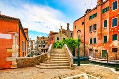 Venice cityscape, bridge stairway and traditional buildings. Italy, Europe. Venice cityscape, bridge stairway, strret lamp and traditional buildings. Italy Royalty Free Stock Photos