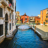 Venice cityscape, bridge, tree and buildings on water grand cana Stock Image