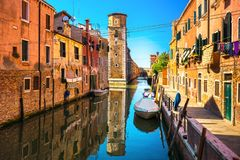 Venice cityscape, buildings, water canal and tower. Italy. Venice cityscape, water canal, tower and traditional buildings. Italy, Europe Royalty Free Stock Photos