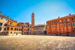 Venice cityscape, Campo S Anzolo square and leaning campanile ch Stock Photos