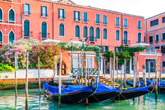 Venice cityscape - gondolas moored at pier on water canal Stock Photography