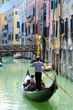 Venice Cityscape - Gondolier rowing gondola Stock Photos