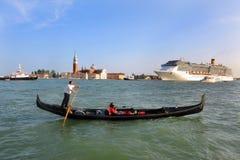 Venice Cityscape - Gondolier rowing gondola Royalty Free Stock Images