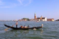 Venice Cityscape - Gondolier rowing gondola Royalty Free Stock Photography