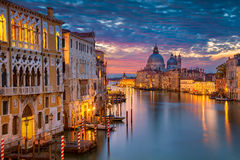 Venice. Cityscape image of Grand Canal in Venice, with Santa Maria della Salute Basilica in the background Stock Photos