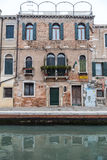 Venice cityscape, narrow water canal, campanile church on background and traditional buildings. Italy, Europe. Royalty Free Stock Photo