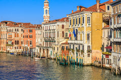 Venice cityscape, narrow water canal, campanile church on background and traditional buildings. Italy, Europe. Stock Photo