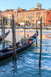 Venice cityscape, narrow water canal, campanile church on background and traditional buildings. Italy, Europe. Stock Photos