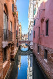 Venice cityscape, narrow water canal, campanile church on background and traditional buildings. Italy, Europe. Stock Images