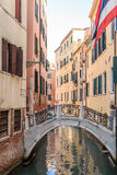 Venice cityscape, narrow water canal, campanile church on background and traditional buildings. Italy, Europe. Stock Image