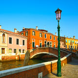 Venice cityscape, street lamp, water canal, bridge and tradition Stock Images