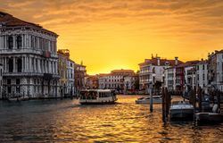 Venice cityscape at sunset, Italy. Panorama of Grand Canal with vaporetto in evening. Urban landscape of Venice in sun light. Beautiful sunny view of the royalty free stock photos