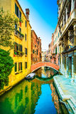 Venice cityscape, sunset in water canal and bridge. Italy Royalty Free Stock Image
