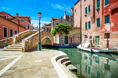 Venice cityscape, water canal, bridge and traditional buildings. Royalty Free Stock Photography