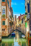 Venice cityscape, water canal, campanile church and traditional buildings. Italy. Venice cityscape, narrow water canal, campanile church on background and Stock Photos