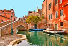Venice colorful corners, old buildings and windows, water canal with boats and small bridge , Italy royalty free stock photo
