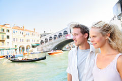 Venice couple by Rialto Bridge on Grand Canal Stock Images