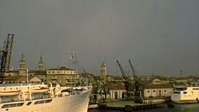 Venice cruise ships. Venice, Italy - circa 1980: big cruise ships docked in Venezia harbor of Giudecca canal. Archival of Venezia city of Italy in the 1980s stock video footage