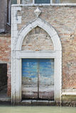 Venice door on canal Royalty Free Stock Photos