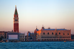 Venice at dusk. View of the St. Mark's Square in Venice with the Campanile, the basilica San Marco and the Doge's Palace from waterside at dusk Stock Photos
