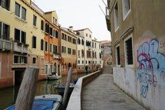 Venice empty narrow street and canal Stock Photography