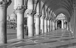 Venice - Exterior corridor of Doge palace and church Santa Maria della Salute Royalty Free Stock Image