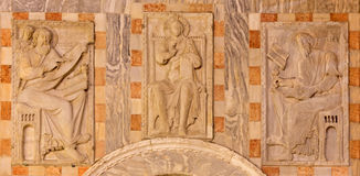Venice - Exterior reliefs from portal of st. Mark cathedral with Christ and the evangelists symbols. Royalty Free Stock Images