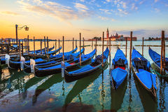 Venice with famous gondolas at sunrise Stock Images