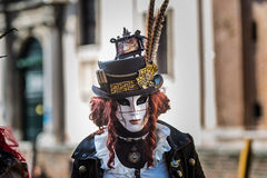Venice - February 6, 2016: Colourful carnival mask through the streets of  Venice Royalty Free Stock Image